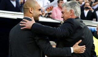 Haben ein gutes Verhältnis: Ex-Bayern-Trainer Pep Guardiola und sein Nachfolger Carlo Ancelotti. (Foto)