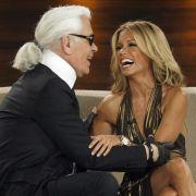 Auch bei den deutschen Stars beliebt: Karl Lagerfeld im munteren Gespräch mit Sylvie Meis.