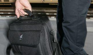 Die Deutsche Bahn warnt vor Taschendieben. (Foto)