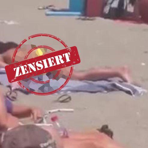 DIESE Frau masturbiert mitten am Strand (Foto)