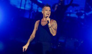 """Robbie Williams hat für 2017 eine neue Tournee geplant und beehrt mit seiner """"The Heavy Entertainment Show""""-Tour auch Deutschland. (Foto)"""