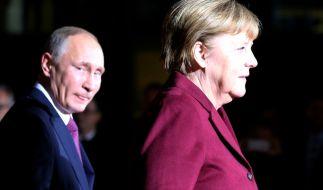 Der russische Präsident Wladimir Putin zu Gast bei der deutschen Bundeskanzlerin Angela Merkel am 19. Oktober anlässlich eines Gipfels zur Ukraine-Krise. (Foto)