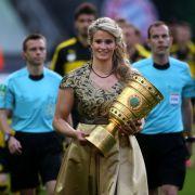 Doppelolympiasiegerin im Rennrodeln ist Natalie Geisenberger aus Deutschland. Zudem ist sie stolze Besitzerin von 12 WM-Medaillen. Im Mai durfte sie den DFB-Pokal beim Finale ins Stadion tragen.
