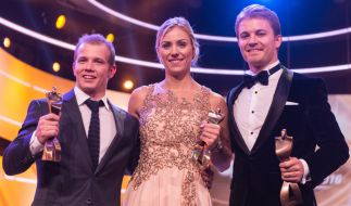 Der Sportler des Jahres, Fabian Hambüchen (l), die Sportlerin des Jahres, Angelique Kerber, und der drittplazierte Sportler des Jahres, Nico Rosberg. (Foto)