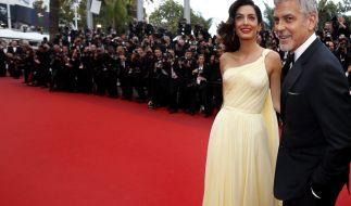 Der Hollywood-Schauspieler George Clooney mit seiner Frau, der Anwältin Amal Alamuddin Clooney. (Foto)
