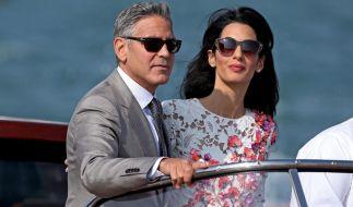 George und Amal Clooney bei ihrer Hochzeitsreise im September 2014. (Foto)