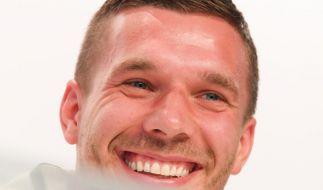 Lukas Podolski eröffnet Eisdiele in Köln. (Foto)
