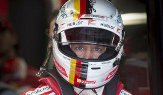 Ferrari-Fahrer Sebastian Vettel aus Deutschland bereitet sich in Montreal auf das 2. Freie Training vor. (Foto)