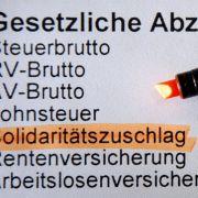 Soli muss weg - Steuerlast könnte um 15 Milliarden Euro sinken (Foto)