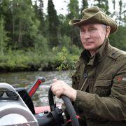 Warum hat Putin einen Zweig in seiner Jackentasche?