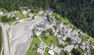 Schlamm und Gesteinsbrocken haben Bondo im Kanton Graubünden (Schweiz) verwüstet. (Foto)