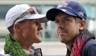 Gut befreundet: Schumi (l.) und Vettel. (Foto)