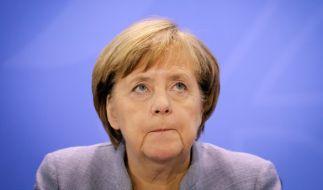 Angela Merkel in Bedrängnis. (Foto)