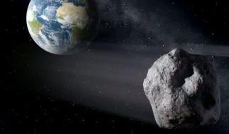 Die künstlerische Darstellung zeigt einen erdnahen Asteroiden im Vorbeiflug (Foto)