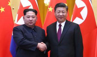 Nordkoreas Diktator Kim Jong-un und Präsident Xi Jinping. (Foto)