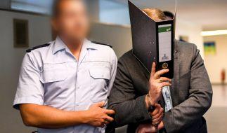 Der wegen Kindesmissbrauchs Angeklagte Knut S. wird von einem Justizbeamten in einen Saal des Landgerichts geführt. (Foto)
