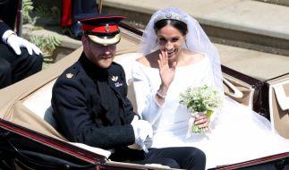 Prinz Harry und seine Frau Meghan Markle. (Foto)