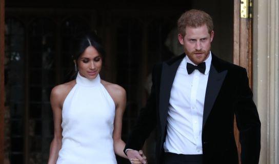 Der britische Prinz Harry und seine Frau Meghan verlassen das Windsor Castle um zum Hochzeitsfest im Frogmore House am Abend zu fahren.