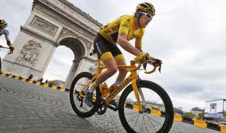 Geraint Thomas krönt sich zum Tour-Champion. (Foto)