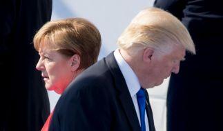 Angela Merkel genießt auf der Weltbühne weitaus mehr Vertrauen als Donald Trump. (Foto)