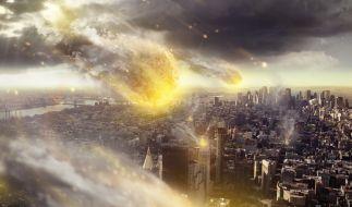 Ein fiktiver Asteroid kracht auf die Erde. (Foto)