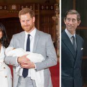 Prinz Harry hält neben Meghan ihren SohnArchie Harrison Mountbatten-Windsor im Arm.