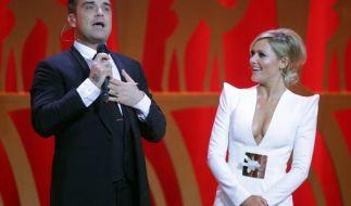 Da staunt Helene Fischer nicht schlecht: Robbie Williams hat sein neues Weihnachtsalbum komplett nackt angekündigt. (Foto)