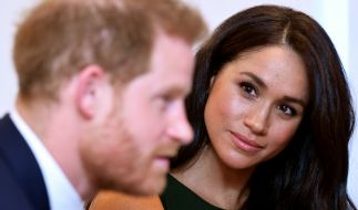Der britische Prinz Harry (l), Herzog von Sussex, und seine Frau Meghan, Herzogin von Sussex. (Foto)