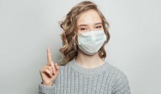 Mundmasken können das Infektionsrisiko senken. (Foto)