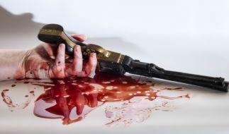 Ein Imbisswagenbesitzer erschoss erst seine Ex-Frau und dann sich selbst. (Symbolfoto) (Foto)