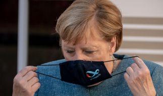 Die Nachrichten des Tages bei news.de: Aufgrund der steigenden Corona-Infektionszahlen drohen Party-Verbote. Einige Städte sind bereits betroffen. (Im Bild: Bundeskanzlerin Angela Merkel) (Foto)