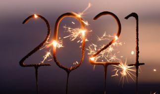 Menschen in aller Welt begrüßen das neue Jahr 2021 - wenn auch aufgrund der Corona-Pandemie ohne Massenveranstaltungen und üppiges Feuerwerk. (Foto)