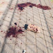Partygäste steinigen Pistolen-Schützen zu Tode (Foto)