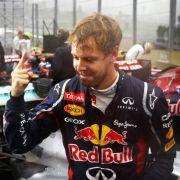 Abgekämpft im Regen: Sebastian Vettel realisiert, dass er gerade zum dritten Mal Weltmeister geworden ist.