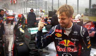 Abgekämpft im Regen: Sebastian Vettel realisiert, dass er gerade zum dritten Mal Weltmeister geworden ist. (Foto)