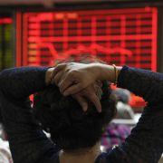 Aktienmärkte in China und Japan weiter im Abwärtssog (Foto)