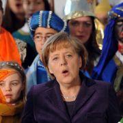 Angela Merkel will, dass die CDU wieder mehr christliche Weihnachstlieder singt. (Foto)