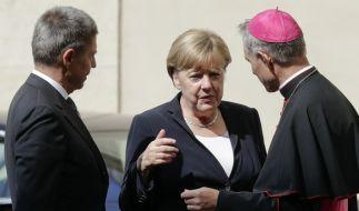 Angela Merkel und ihr Ehemann Joachim Sauer sind zu einer Privataudienz von Papst Franziskus eingeladen. (Foto)