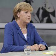 Merkel stimmt die Deutschen ein: Mehr als 400.000 Flüchtlinge werden kommen (Foto)