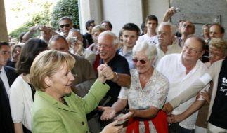 Angela Merkel und das Volk (Foto)