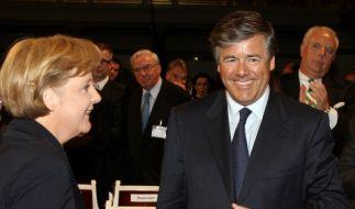 Angela Merkel und Josef Ackermann in Feierlaune (Foto)