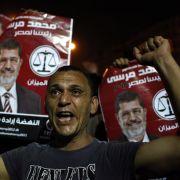 Anhänger der Muslimbruderschaft demonstrieren auf dem Tahrir-Platz für Mohammed Morsi als neuen ägyptischen Präsidenten.