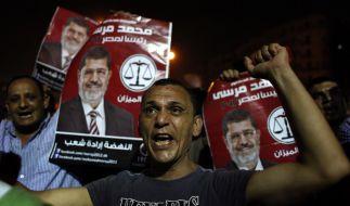 Anhänger der Muslimbruderschaft demonstrieren auf dem Tahrir-Platz für Mohammed Morsi als neuen ägyptischen Präsidenten. (Foto)