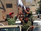 Aufständische in Aleppo: In den größten syrischen Städten tobt die Entscheidungsschlacht zwischen Militär und Aufständischen. (Foto)