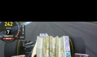 Bei Tempo 242 km/h mal eben den Stadtplan von Sao Paulo aus dem Handschuhfach gekramt: Kimi Räikkönen. (Foto)