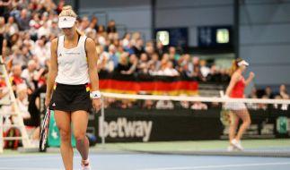 Belinda Bencic aus der Schweiz jubelt, die deutsche Tennisspielerin Angelique Kerber (l) ist enttäuscht. (Foto)