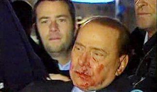 Berlusconi mit Gegenstand niedergestreckt (Foto)