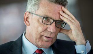 Bundesinnenminister Thomas De Maizière fordert kürzere Leistungen für Asylbewerber. (Foto)