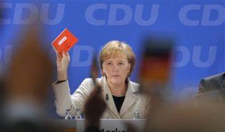 Bundeskanzlerin Angela Merkel stimmt für den Koalitionsvertrag.  (Foto)