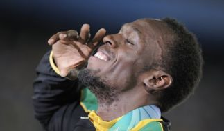 Der 100-Meter-Lauf mit Usain Bolt gehört zu den Highlights im Zeitplan bei Olympia 2012. (Foto)